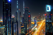 Arab Photo Framed Prints - Sheikh Zayed Road in Dubai Framed Print by Lars Ruecker