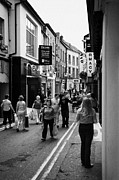 Republic Prints - Shoppers Walking Up The Narrow Main Street Of Wexford Town Print by Joe Fox