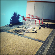 Commerce Photo Prints - Shopping trolleys  Print by Les Cunliffe