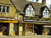 Up On The Roof Photos - Shops in Cute Buildings Bourton on the Water Cotswold District Gloucestershire England by Robert Ford