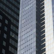 Featured Metal Prints - Side Of An Office Towers With Glass Metal Print by Keith Levit