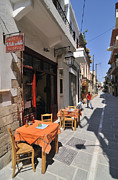 Inns Prints - Sidewalk cafe in Greece Print by Matthias Hauser