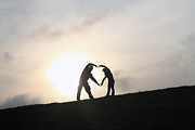 Hands Acrylic Prints - Silhouette Couple forming a heart Acrylic Print by Lars Ruecker