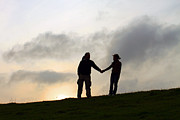 Hands Acrylic Prints - Silhouette Couple holdings hands Acrylic Print by Lars Ruecker