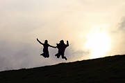 Silhouette Photos - Silhouette Jumping Couple by Lars Ruecker