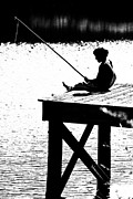 Book Cover Prints - Silhouette of a Boy fishing from a dock on lake or pond.  Print by Jt PhotoDesign