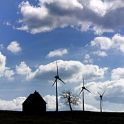 Wind Turbines Framed Prints - Silhouette of a farm and a tree Framed Print by Bernard Jaubert