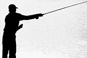 James BO  Insogna - Silhouette of a Fisherman Holding a Fishing Pole BW