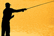Angling Framed Prints - Silhouette of a Fisherman Holding a Fishing Pole Gold Framed Print by James Bo Insogna