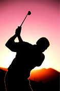Round Of Golf Prints - Silhouette of a golfer with a driver about to take a shot Print by Lanjee Chee