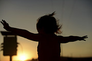 Carefree Photos - Silhouette Of A Playful Young Girl  by Shahar Tamir