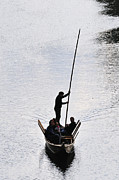 Gondolier Prints - Silhouette of a punt on the river Print by Matthias Hauser
