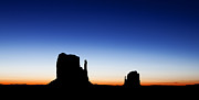 Monument Valley Posters - Silhouette of the Mitten Buttes in Monument Valley  Poster by Susan  Schmitz