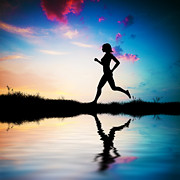 Jog Posters - Silhouette of woman running at sunset Poster by Michal Bednarek