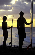 Surf Silhouette Prints - Silhouetted surfers at Noosa Heads Print by Sean Davey