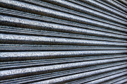 Entrance Shop Front Prints - Silver Metal Roller Security Shutters Closed Down Print by Fizzy Image