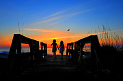 Dan Friend - Sisters holding hands watching sunrise