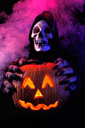 Jack O Lantern Photos - Skeleton holding pumpkin  by Garry Gay