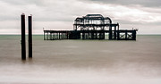Grey Clouds Prints - Skeleton of West Pier at Brighton Print by Semmick Photo