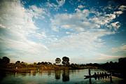 Indian Rhinoceros Posters - Sky and river wuth boat Poster by Raimond Klavins