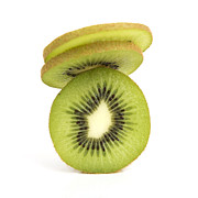 Healthy Eating Metal Prints - Sliced kiwis Metal Print by Bernard Jaubert