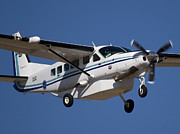 Cessna Photos - Slow Flying by Paul Job