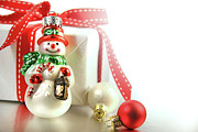 Snowman Posters - Small christmas ornament with gift Poster by Sandra Cunningham