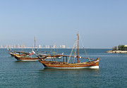 Wooden Ship Framed Prints - Small dhows and Pearl development Framed Print by Paul Cowan