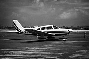 Single-engine Framed Prints - Small Single Engined Piper Private Aircraft Taxis In Key West International Airport Florida Keys Usa Framed Print by Joe Fox