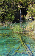 Turquoise Mountain Lake Prints - Small waterfall and an emerald colored lake Print by Kiril Stanchev
