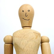 Toys Prints - Smiling wooden figurine Print by Bernard Jaubert
