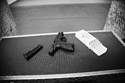 Practise Framed Prints - Smith And Wesson 9mm Handgun With Ammunition At A Gun Range In Florida Usa Framed Print by Joe Fox
