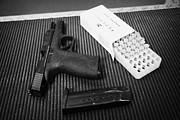 Practice Range Prints - Smith And Wesson 9mm Handgun With Ammunition At A Gun Range Print by Joe Fox