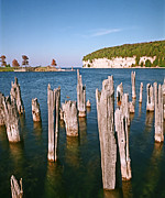Wood Pylons Photos - Snail Shell Harbor by James Rasmusson