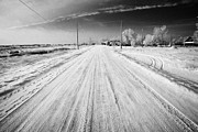 Snow Covered Village Posters - snow covered road in small rural farming community village Forget Saskatchewan Canada Poster by Joe Fox