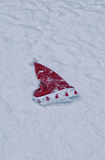 Santa Claus Prints - snow-covered Santa hat Print by Joana Kruse
