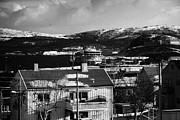 View Over Framed Prints - Snow Covered Street Of Traditional Wooden Houses Looking Down To Hurtigruten Ship In Kirkenes Harbou Framed Print by Joe Fox