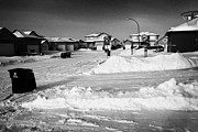 Driveways Prints - snow covered upmarket residential street during winter Saskatoon Saskatchewan Canada Print by Joe Fox