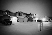 Snow Falling Prints - snow falling in residential neighborhood in Saskatoon Saskatchewan Canada Print by Joe Fox