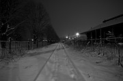 Snowy Night Night Photo Prints - Snow on the Tracks Print by Mike Horvath