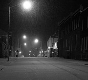 Snowy Night Night Framed Prints - Snowing on w. Fourth St. Framed Print by Julie Dant