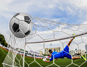 Victory Field Photo Prints - Soccer Ball In Goal  Print by Anek Suwannaphoom
