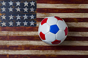 Games Photo Framed Prints - Soccer ball on American flag Framed Print by Garry Gay
