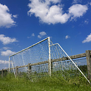 Soccer Goal Framed Prints - Soccer goal net against cloudy sky Framed Print by Bernard Jaubert