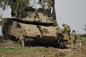 Featured Acrylic Prints - Soldiers Climb Into An Israel Defense Acrylic Print by Ofer Zidon
