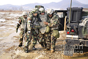 Helping Prints - Soldiers Conduct Medical Evacuation Print by Stocktrek Images