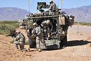 Strategy Posters - Soldiers Dismount From A Stryker Poster by Stocktrek Images