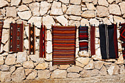 Rugs Posters - Souvenir rugs for sale at Wadi Mujib Jordan Poster by Robert Preston