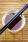 Dishes Posters - Soy sauce with chopsticks Poster by Elena Elisseeva