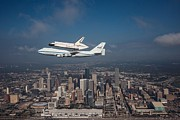 Space Shuttle Endeavour Prints - Space Shuttle Endeavour Over Houston Texas Print by Movie Poster Prints